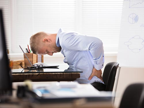 Office-worker with lower back pain