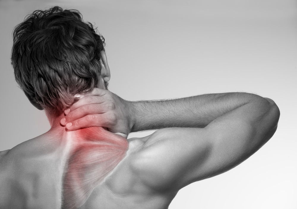 Man with neck pain and referred pain